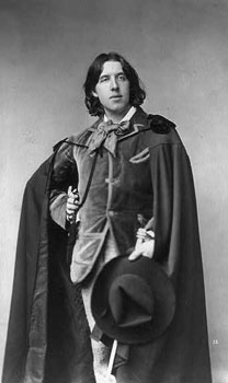 Long-haired Wilde in one of his velvet suits